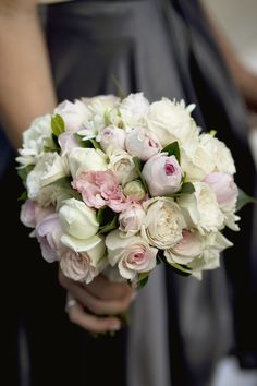 White roses, pink David Austin roses, champagne lisianthus, single tuberoses and camellia and gardenia foliages.  Photograph by Summerton Photography