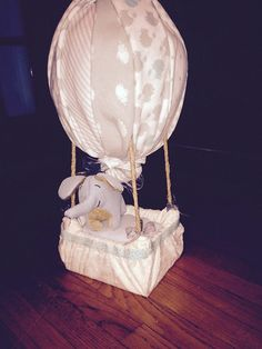 Oh, the places you will go in this unique hot air balloon diaper cake!  Ingredients: 38- size one pampers swaddlers diapers 1- bowl 4- spoons 1- container of cleansing towelettes 1- outfit/ onesie 3- washcloths 6- receiving blankets 1- sheet or changing pad cover 1- stuffed animal   All products are useable after balloon is taken apart. Just throw out the box and  rope.  Your diaper cake is a made to order product and can be any theme or color scheme you can think of.  ...