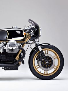 Which famous 1970s Formula 1 race team livery does this Moto Guzzi Le Mans custom remind you of ..?