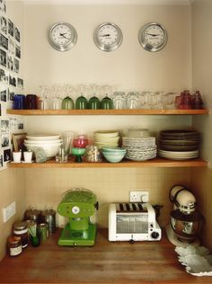 Rita Konig - desire to inspire - desiretoinspire.net | open shelves with a pretty assortment of mismatched dishes