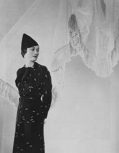 Wallis Simpson in a dress byElsa Schiaparelli  (the pattern is of matchsticks). Photo: Cecil Beaton.