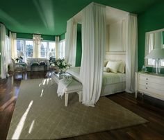 love the green ceiling and walls of this bedroom