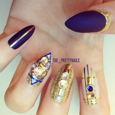 amazing purple and gold glitter claws / stiletto nail art / almond nails