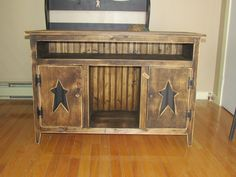 Primitive TV Stand. Want something like this! Like the wood, but also think it would look good in lamp black! Hm.