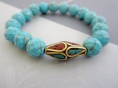 Turquoise bracelet, Howlite bracelet, Buddhist jewelry, Tibetan Guru Bead, wrist Mala.. $34.00, via Etsy.