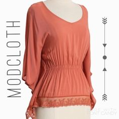 Lush apricot blouse detailed back Beautiful apricot top with laced details on back. Only worn twice! Gathered at the waist and flows out.  Small dot by right shoulder. You can hardly see it but I wanted to include it! From modcloth. Lush Tops Blouses