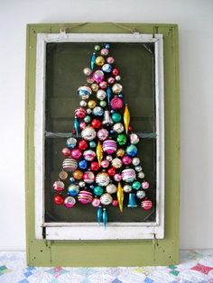 Small space DIY Christmas tree ideas // unique way to make your own wall tree... use an upcycled screen and ornaments.