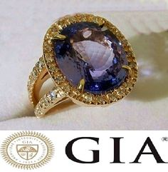 Catawiki 全球網上拍賣: Ring with 12.98 ct Tanzanite and Diamonds 18 kt/750 Yellow Gold - Size: 17.2 - GIA Certificate