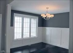 The Formal Dining Room 39 S Tall Wainscoting Is Clic A Custom Home By Master Builder Blade