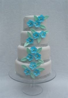 This wedding cake is decorated with stunning blue wafer flowers, with a diamanté trim. Please note the colours and flowers can be changed to suit your wedding. Wafer Paper Flowers, Sugar Flowers, Blue Flowers, Amazing Wedding Cakes, Amazing Cakes, Beach Wedding Inspiration, Wedding Ideas, Flower Boutique, Celebration Cakes