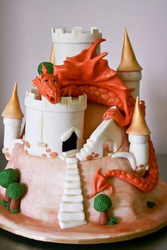 My son, Jonathan, turned 9 and this is what he requested for his birthday cake. It's based on a design by Debbie Brown. Chocolate Jaffa cake covered in fondant. Dragon was made from icing. Pretty Cakes, Beautiful Cakes, Amazing Cakes, Crazy Cakes, Fancy Cakes, Pink Cakes, Cupcakes, Cupcake Cakes, Shoe Cakes