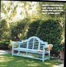 Idea from Domino magazine: a blue bench centered in the back yard draws your eye