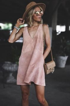 The Free People Retro Love Blush Pink Suede Leather Shift Dress has us swooning over it's throwback style! Luxuriously soft genuine suede shapes this sleeveless, shift dress with a darted bodice, plunging V-neckline, and handy side seam pockets. Exposed silver zipper at back. As Seen On Emily of @emilyrosehannon and Kemper of @joandkemp!