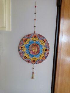 Mandala feita em jornal