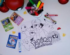 Pokémon coloring pages are a great way to keep little hands busy as food is served or while waiting for all guests to arrive. We found free printable pages online and placed at tables with crayons and washable markers. Photo and blog at eversosweetparty.wordpress.com