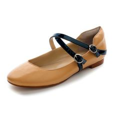 I love these caramel and black leather flats - their simplicity makes them stand out.