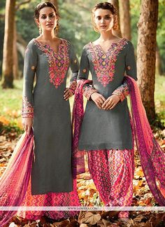 Appear stunningly stunning with this grey and pink cotton satin designer suit. This lovely dress is showing some unbelievable embroidery done with embroidered and print work. Comes with matching botto...