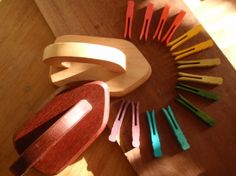 Handmade wooden toy iron set with rainbow clothespins. Woodworkers could make these.