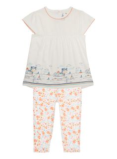 Prep their holiday range with this bright tee and leggings set. The top is designed with an embroidered yoke, gathered skirt and a unique sea-side pattern at the hem. The leggings feature a colourful floral pattern that completes the sunny look. Multicoloured tee and leggings set Embroidered yoke Seaside and floral patterns Gathered skirt Scalloped trim Rear pop fastening Keep away from fire