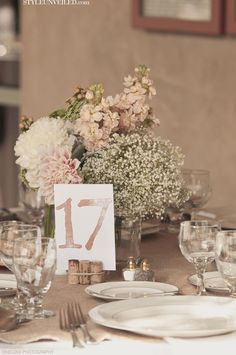 Inspiration for my wedding table settings... i like the cork table holder