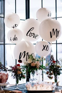 Move over flowers! We are loving wedding balloon decor! Shop these oversized love balloons, mr and mrs balloons, I Do balloons and XO balloons at davidsbridal.com #weddingideas