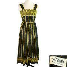"Miss Elliette Black Yellow Embroidered Maxi Dress Miss Elliette Haute Hippie, Vintage Prom Black White Polka dot with Yellow Soutache and Embroidered Dot Stipes Sheer Layer over Black Lining Approximate Small pictured on size 6 Mannequin No RN or Fabric Tags Another like new dress from the coolest estate!!! Excellent like new condition!  ?------measurements------- (all taken with the garment laying flat)  Chest 17-1/2"""" Length top of strap to waist 14"" Length top of strap Hem 54"" Waist 13""…"