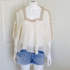 FREE PEOPLE white flowy blouse with sequins Large Flowy soft white blouse from FREE PEOPLE size large. Features flowy sleeves and sequins along the square neckline and sleeves. Free People Tops Blouses