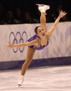 Figure skater Michelle Kwan wins the women's figure skating short program at the Delta Center, but later stumbles in her free skate and settles for the bronze meda