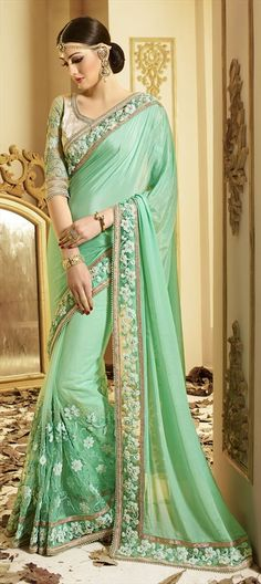 197347 Green  color family Embroidered Sarees, Party Wear Sarees in Faux Georgette, Net fabric with Lace, Machine Embroidery, Moti, Resham, Thread work   with matching unstitched blouse.