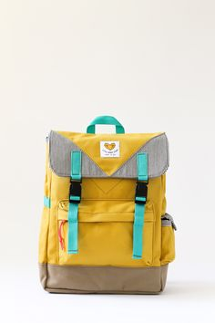 Presenting: BACKIE THE BACKPACK! Get ready for adventures out in the wild and in the wild city! Made with the cheeriest and strongest mustard yellow canvas, Backie is a water-resistant backpack ideal