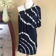 """Young Fabulous & Broke BRAND NEW tie dye dress Young Fabulous & Broke BRAND NEW tie dye dress in gorgeous midnight blue and off white.   Ruching at each hip and one shoulder design. Never worn has tiny hole from security tag as seen in 4 th pic next to fabric label at bottom of dress otherwise excellent condition. Elastic around top of dress. Extremely soft and comfy. Measures 38"""" long 16"""" across bust. Lots of stretch Young Fabulous & Broke Dresses One Shoulder"""