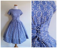"Gorgeous Cornflower blue and ecru corset bodice dress from 1950s dress maker Gay Gibson. Absolutely stunning mountain flower novelty print on a cotton rayon blend that both breathes and holds its shape. Gorgeous crocheted lace trim around wide neckline and sleeves. Slightly longer than average bodice laces up the front cinching the long waistline in a dirndl ""Oktoberfest"" style that reminds me of the ballet ""Giselle."""