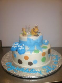Calumet Bakery  Fondant Baby Shower Cake with Fondant Booties and Bow.  Zoo Animal toys on top.
