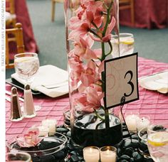 Use fake flowers for centerpieces. Looks the same, saves hundreds! Wont wilt in hot sun or brown over time! Click link for helpful hints on how-to.