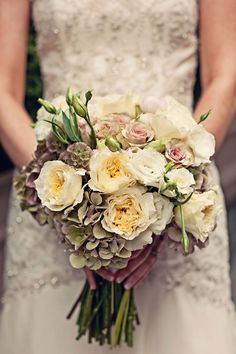 Beautiful hand-tied bouquet made with hydrangea, lisianthus, roses and scabiosa pods. Created by Christopher Flowers.