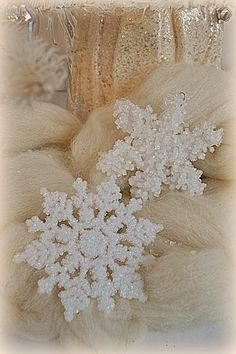 Holiday Magic: Fancified Borax Crystal Snowflakes {and Candle-lit Centerpieces}.  These ornaments are so easy and inexpensive.  All you need are dollar store ornaments, Borax, and hot water.  #craft