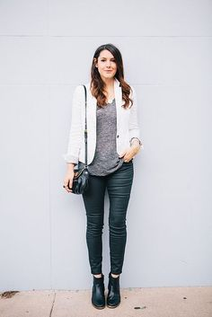 Grey tee, white leather jacket, green skinnies, black boots