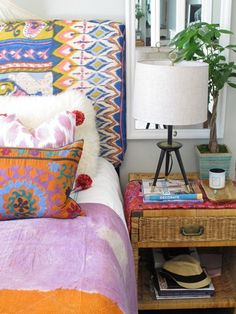 That ikat headboard, the suzani pillow, the ikat pillow, and tie dye on the bed!  by Amber Interiors