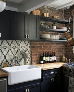 Beautifully Unique Home➡http://decoholic.org/2016/06/19/beautifully-unique-home/  #decoholic #interiordesign #inspiration #kitchen #blackkitchen #brickwall
