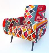Chairs are all covered with different antique kilims sourced by Xerri