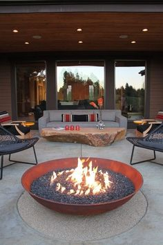 I love everything about this outdoor living space .... The sofa, the boulder table, the copper fire bowl, the modern chairs.... A slice of heaven!  (houzz.com)