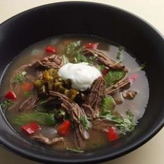 Fragrant Shredded Beef Stew goes together fast and then just simmers in the crock pot. Skip the corn tortillas on the side (and the dollop of sour cream in this photo -- it's not in the recipe)