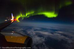 Auroras boreales desde un avión sobre la bahía de Hudson, Canadá. 14 de octubre de 2013 Crédito: David Mayhew