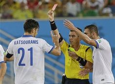 Referee Joel Aguilar from El Salvador shows a red card to Greece's Kostas Katsouranis, left, during the group C World Cup soccer match between Japan and Greece at the Arena das Dunas in Natal, Brazil, Thursday, June 19, 2014. (AP Photo/Ricardo Mazalan) ▼19Jun2014AP|Scoreless draw keeps Japan and Greece alive http://bigstory.ap.org/article/scoreless-draw-keeps-japan-and-greece-alive #Japan_Greece_group_C #Brazil2014