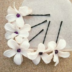 I'm thinking these with the big purple furry flower in my hair?  Flower Bobby Pins with Purple crystal centers by embellishingyou, $10.00