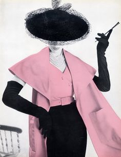 Cristóbal Balenciaga 1951 Cigarette Holder, Long gloves and the HAT--this is the closest that comes to a picture I remember seeing as a kid that was a seated woman, and framed to be mostly the curve of the hat and the cigarette holder--must have been a local artist because I can't find it anywhere