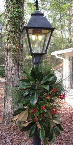 Greens on the lampost.brought magnolia leaves from down south! It is not Christmas without magnolia leaves! Southern Christmas, Christmas Porch, Outdoor Christmas Decorations, Winter Christmas, Christmas Wreaths, Christmas Lamp Post, Xmas, Christmas Greenery, Merry Christmas