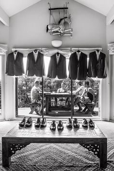 Hilary Cam Photography captured the groom and his groomsmen kicking back, along with all of their outfits and accessories, in this artfully composed shot.                                                                                                                                                     More