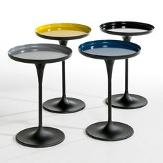 Metal pedestal table. The glossy coated top on the central base will jazz up your home!