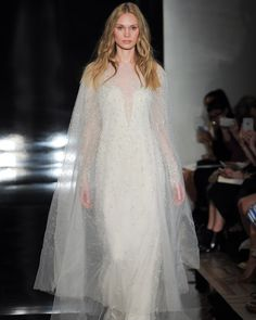 This Reem Acra Spring 2017 gown makes a serious case for bridal ponchos. And look how the little silver embellishments make it sparkle as it moves!